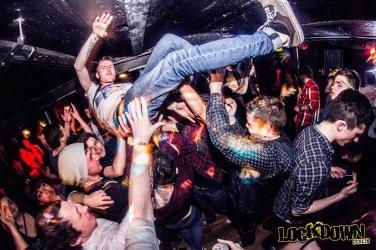Man crowdsurfing at nightclub